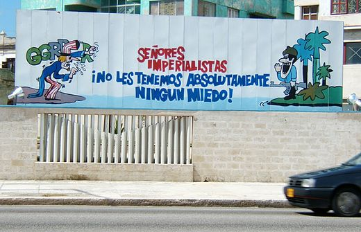"Cuban propaganda poster in Havana featuring a Cuban soldier addressing a threatening Uncle Sam. The translation reads: ""Imperialist sirs, we have absolutely no fear of you!"" Billboard opposit USA interest office.jpg"