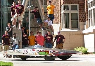 Borealis III solar car, and several members of UMNSVP 2006 team.jpg