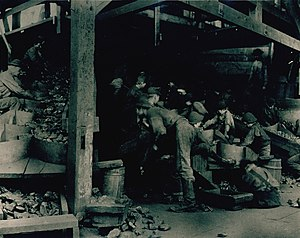 Breaker boy - Breaker boys in the 1880s picking slate from coal at a coal breaker in Pottsville, Pennsylvania. Photo by George Bretz, 1880s
