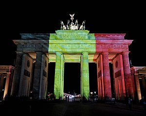 Reactions to the 2016 Brussels bombings - Berlin's Brandenburg Gate illuminated with the colours of Belgium's flag.