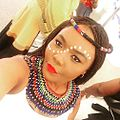 Bridesmaid at a Xhosa wedding in Zulu attire.jpg