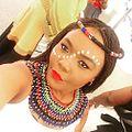 Bridesmaid at a Xhosa wedding in Zulu attire.jpg