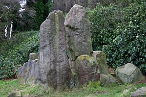 several large standing stones with some stacked