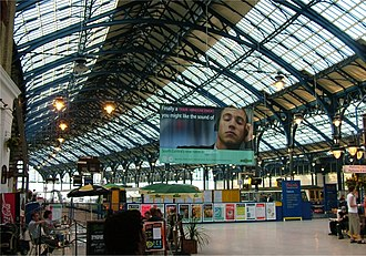 Southern (Govia Thameslink Railway) - A sign at Brighton station showing the name change from South Central to Southern in 2004.