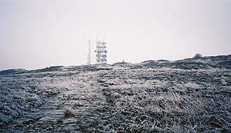 Clee Hills - Abdon Burf, the summit of the Brown Clee in freezing conditions. The radar masts are clearly visible.