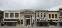Buildings on the square surrounding the Williamson County Courthouse in Georgetown, Texas LCCN2014633715.tif