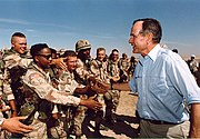 President Bush visited American troops in Saudi Arabia on Thanksgiving Day, 1990