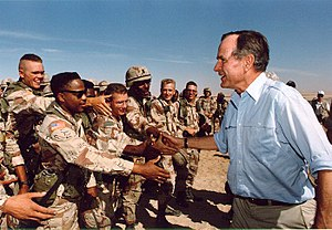 President Bush visiting American troops in Sau...