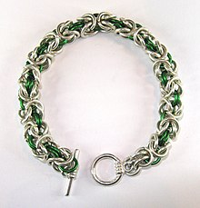 9edb39960 Chain mail bracelet, in Byzantine weave, with silver-plated copper rings  and green aluminium rings