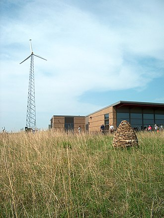 Conard Environmental Research Area - The cairn by Andy Goldsworthy is in the foreground, with the new wind turbine and Environmental Education Center in the background.