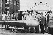 Captain Theodore Westfall and Captain Carl Bushnell of the Bureau of Ordnance, inspect the Naval Torpedo Station's first Mk 14, 1943