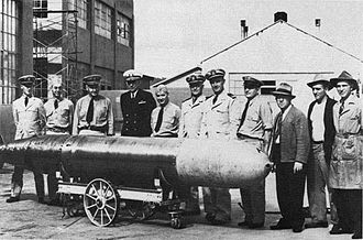 Mark 14 torpedo - Captain Theodore Westfall, NTS CO and Captain Carl Bushnell of the Bureau of Ordnance, inspect a Mark 14 torpedo at the Naval Torpedo Station, Keyport, Washington, 1943