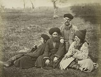 Mountain Jews - Mountain Jews with chokha resting after a day of work.