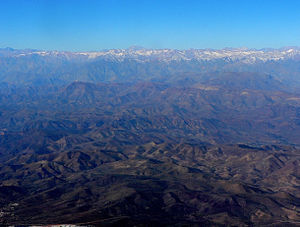 Cerro Pachón - Wide view observatories from the air, including Cerro Pachón. In the distance are the Andes