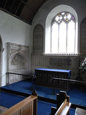 Holcombe Burnell - Chancel of Holcombe Burnell Parish Church looking eastwards, showing the 16th-century Easter Sepulchre monument to a member of the Denys family, north wall of chancel