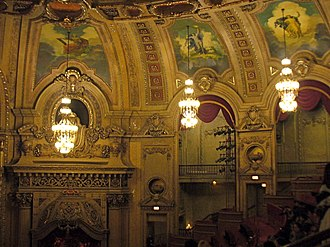 Chicago Theatre - Auditorium detail showing murals, chandeliers, and gilded decorations.