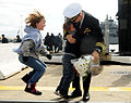 Children express their excitement as they welcome home their father from a six-month deployment of the Los Angeles-class attack submarine USS Norfolk (SSN 714) at Naval Station Norfolk, Va., on Nov 121103-N-EP471-023.jpg
