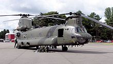 Two large military helicopters on a runway.