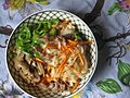 Chopped capsicum, mushroom, meat, carrot with rice noodles mixing.jpg