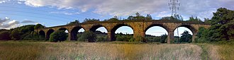 East Lancashire Railway (1844–1859) - The disused Clifton Viaduct.  It crosses the Manchester Bolton & Bury Canal and the River Irwell.  Clifton Junction is to the south of the viaduct.  Now a Grade II listed structure, the bridge is presently closed to pedestrians.