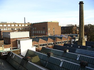 Department of Engineering, University of Cambridge - Cambridge University Engineering Department Trumpington Street site looking southeast from the Inglis A Building in Nov 2004. The Baker Building is in the left background and the Leys School is in the right background (behind the chimney). The Inglis Building is in the middle and foreground.