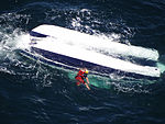 Coast Guard rescue swimmer searching for missing boaters 130805-G-ZZ999-007.jpg