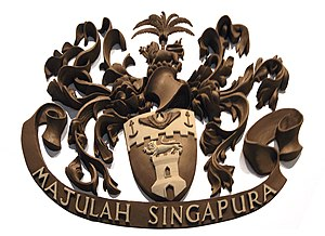 "Majulah Singapura - The coat of arms of the Singapore Municipal Commission in Victoria Theatre, with the motto ""Majulah Singapura"""
