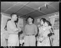Commodore Charles T. Dikeman talks with F. Sugiyama, Sec-Treas of local UMWA and his wife. Hudson Coal Company... - NARA - 540488.tif