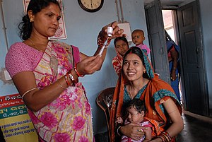 Women's health in India - Community health worker preparing a vaccine in Odisha, India