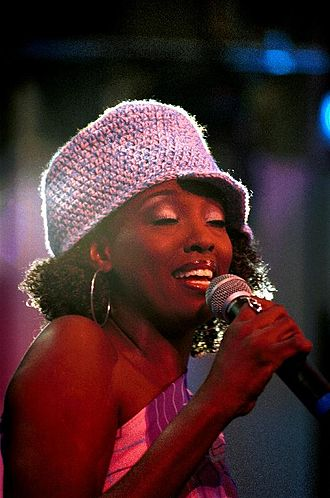 Conya Doss - Conya Doss performing at the Rock and Roll Hall of Fame in Cleveland, Ohio, in February 2003
