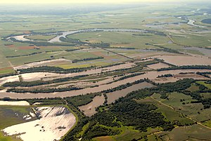 Big Lake State Park - Big Lake (the curved area in the upper left) on June 15, 2011 during the 2011 Missouri River floods with the Missouri River in the foreground.  The park itself is on the east side (the top of the lake in the photo)
