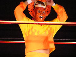 Curry Man standing in a wrestling ring