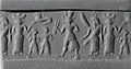Cylinder seal and modern impression- war goddess flanked by goddesses with Egyptian-style sun-disk headdress and vertical wings MET ss1984 383 19.jpg