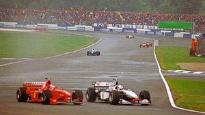 1998 British Grand Prix - Michael Schumacher and David Coulthard side by side