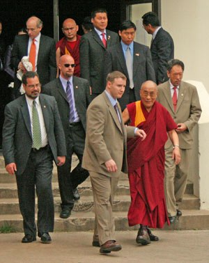 Diplomatic Security Service - DSS Special Agents escort the Tibet leader Dalai Lama from a speaking engagement at Rice University