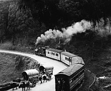 Steam passenger train rounding a curve