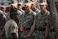 Defense.gov News Photo 100804-M-1365Z-042 - U.S. Marine Corps recruits attached to Platoon 3052 Lima Company 3rd Battalion stand at parade rest while Sgt. Harold Shade left talks during.jpg
