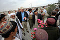 Defense.gov News Photo 101028-D-7203C-019 - Deputy Secretary of Defense William J. Lynn III and Governor Ghulab Mangal receive flowers while visiting a newly constructed school in Nawa.jpg