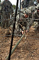 Defense.gov News Photo 110715-N-KG738-614 - U.S. Army soldiers with the 38th Engineer Company 4th Stryker Brigade 2nd Infantry Division place a Bangalore explosive to clear a barbed wire.jpg