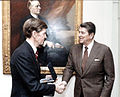 Defense Intelligence Agency's (DIA) John T. Hughes with President Reagan.jpg