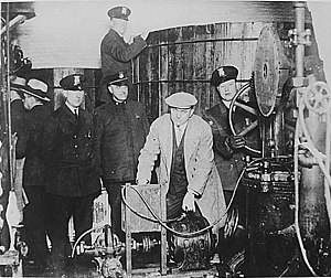Alcohol law - Detroit police inspecting equipment found in a clandestine brewery during the Prohibition era.