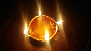 Arya Samaj - Diya with two wicks, pointing in each direction (N, W, S, E).