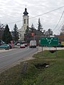 Directional road sign and Saint Stephen of Hungary Church, 2019 Isaszeg.jpg
