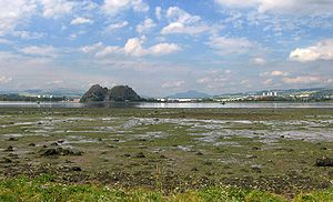 Kingdom of Strathclyde - Dumbarton seen across the estuary of the River Clyde at low tide.