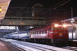 Hokuriku (train) - A down Hokuriku service at Takaoka Station, hauled by an EF81 locomotive, January 2010