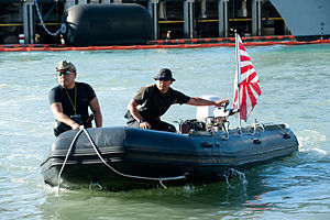 EOD divers from JS Bungo move a boat during RIMPAC 2012, -10 Jul. 2012 a.jpg