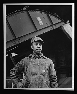 Watts Bar Dam - Earl M. Qualls, car dumper operator at Watts Bar, in June 1942.  This image was distributed by the Office of War information to demonstrate the importance of the dam's electricity as well as the contribution of African-Americans to the war effort.