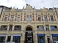 Eclectic listed dwelling building with shops. - 6 Arany János St., Kecskemét 2016 Hungary.jpg