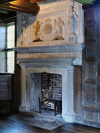 Little Moreton Hall - Fireplace in the Parlour with plasterwork overmantel displaying the royal arms of Queen Elizabeth I, circa 1559 with Caryatids on either side