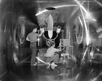 Supersonic wind tunnel - Engineers check an aircraft model before a test run in the Supersonic Wind Tunnel at Lewis Flight Propulsion Laboratory.